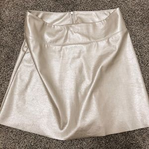CUTEST gold mini skirt!
